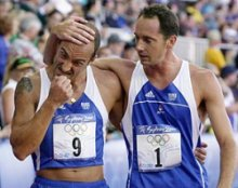 France's Olivier Clergeau, right, comforts countryman Sebastien Deleigne after neither won medals for France in the Modern Pentathlon which includes shooting, fencing, swimming, horseback riding and running Saturday, Sept. 30, 2000, during the Summer Olympic Games in Sydney, Australia.